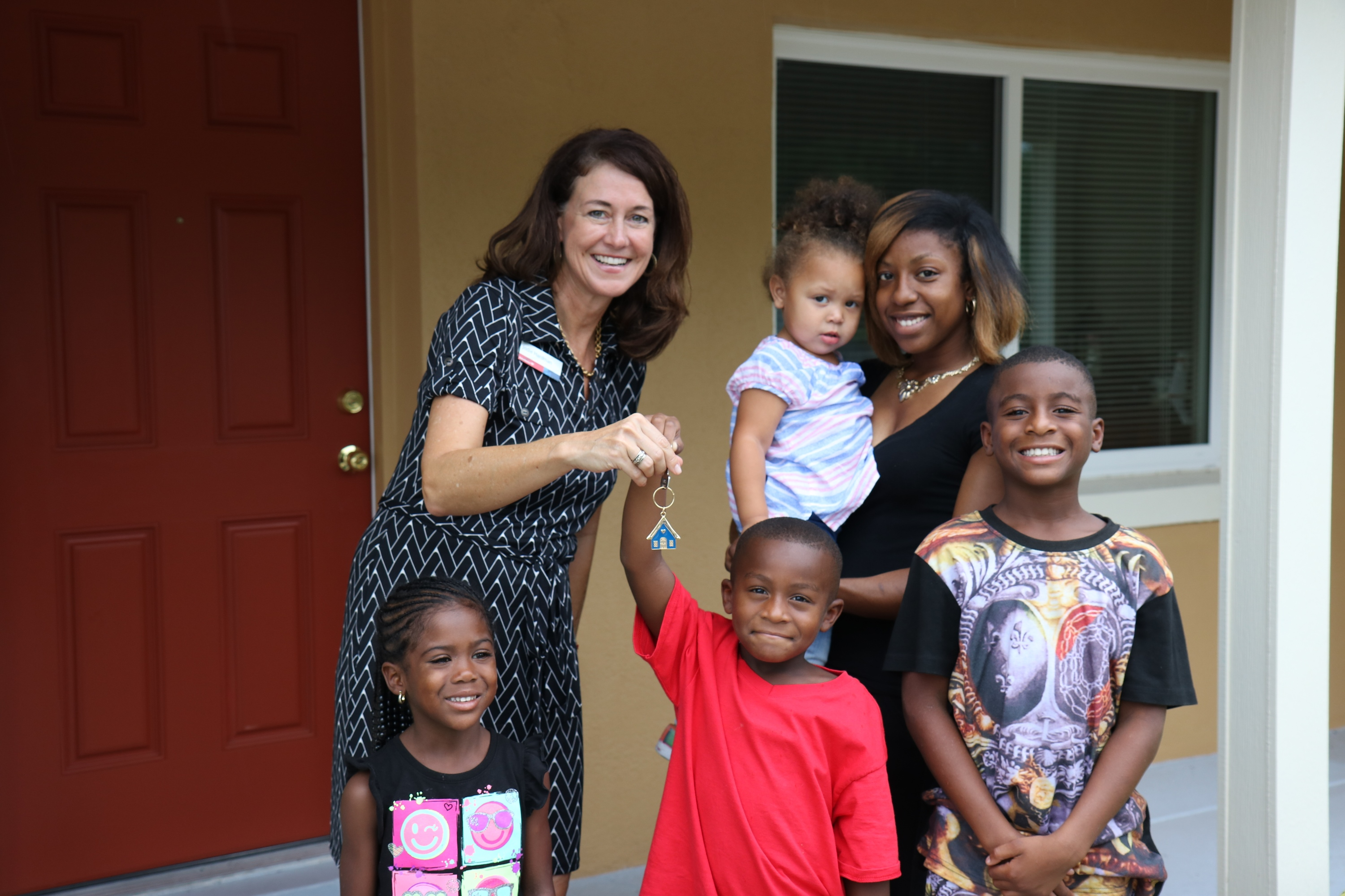 Marcella and her family pictured with Jodi Hardman, SVP, Market Manager, Bank of America